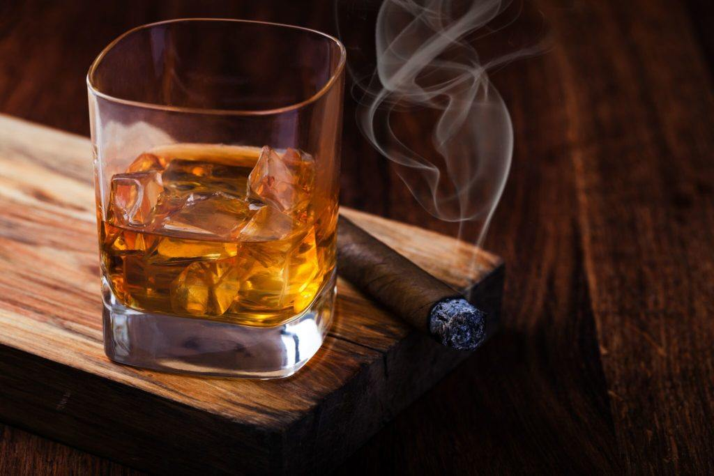 Photo of whiskey and cigar